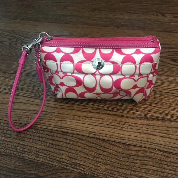 Coach pink and white fabric and leather wristlet